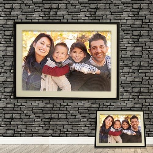 family portait on brick wall